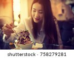woman eating a icecream desert  ... | Shutterstock . vector #758279281