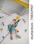 child climbing on a high wall | Shutterstock . vector #758319907