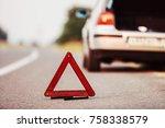 a broken car is standing by the ... | Shutterstock . vector #758338579