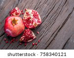 ripe pomegranate fruits on the... | Shutterstock . vector #758340121