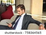 young businessman sitting... | Shutterstock . vector #758364565