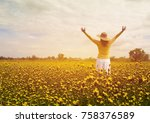 a woman in a white skirt holds... | Shutterstock . vector #758376589