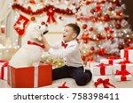 child getting christmas dog... | Shutterstock . vector #758398411