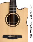 Small photo of Acoustic guitar close up on white background