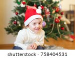 boy in front of christmas tree... | Shutterstock . vector #758404531