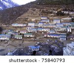 The village of Namche Bazaar along the trail to Mt Everest - stock photo