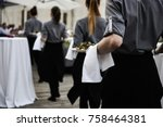 Waiter Carrying Plates With...