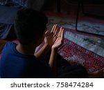 a young islam man is praying in ... | Shutterstock . vector #758474284