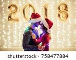 Young Romantic Couple In Santa...