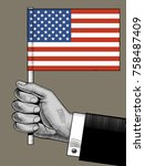 hand holding the usa flag.... | Shutterstock .eps vector #758487409