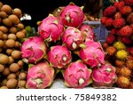 A Colorful Pile of Dragon Fruit in a Street Market in Cambodia - stock photo