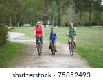 family riding bicycles in... | Shutterstock . vector #75852493