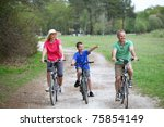 family riding bicycles in... | Shutterstock . vector #75854149