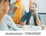 three creative workers meet... | Shutterstock . vector #758549029