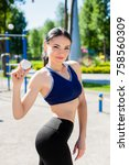 young sportive woman in a... | Shutterstock . vector #758560309
