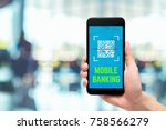 hand holding mobile banking use ... | Shutterstock . vector #758566279