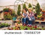 two cute friendly florist girls ...   Shutterstock . vector #758583739