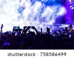 hand with a smartphone records... | Shutterstock . vector #758586499