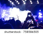 hand with a smartphone records... | Shutterstock . vector #758586505
