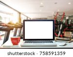 front view of cup and laptop on ... | Shutterstock . vector #758591359