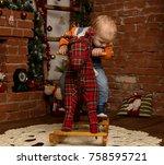 little baby boy on rocking... | Shutterstock . vector #758595721