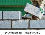 mason on laying bricks.home... | Shutterstock . vector #758599759