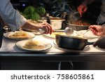 chefs plating up meat soup and...   Shutterstock . vector #758605861