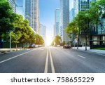 empty highway with cityscape of ...