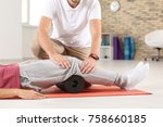 physiotherapist working with... | Shutterstock . vector #758660185