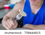 muscular man with roast chicken ... | Shutterstock . vector #758666815