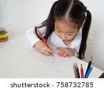 school girl drawing picture... | Shutterstock . vector #758732785