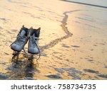 white figure skates on icy lake ... | Shutterstock . vector #758734735