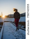 young attractive woman jogging... | Shutterstock . vector #758743555