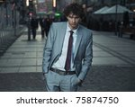 elegant man posing on a city... | Shutterstock . vector #75874750