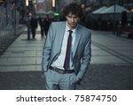 elegant man posing on a city... | Shutterstock . vector #75874750