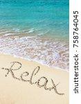 relax handwritten on sandy... | Shutterstock . vector #758764045