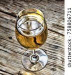 a glass of white wine on a... | Shutterstock . vector #758806711