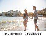 happy couple walking on coast... | Shutterstock . vector #758820961