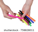 Small photo of Difficult agonizing choice of a colored felt-tip pen from a heap concept. Isolated on white top view studio shot