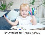portrait of little girl playing ... | Shutterstock . vector #758873437