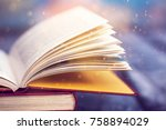 open book with magic lights.... | Shutterstock . vector #758894029