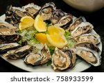 fresh oysters and lemon on...   Shutterstock . vector #758933599