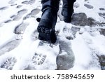 dirty footprints in the snow in ... | Shutterstock . vector #758945659