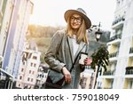 fashionable girl in the city.... | Shutterstock . vector #759018049