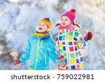 kids playing in snow. children... | Shutterstock . vector #759022981