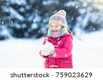 child playing with snow in... | Shutterstock . vector #759023629