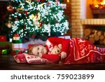 child sleeping at fire place on ... | Shutterstock . vector #759023899