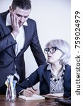 Small photo of Angry boss angry on a new employee and she is shocked (Business, gender, subordination, work concept)