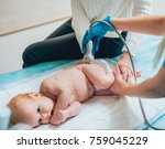 Small photo of Doctor and little boy patient. Ultrasound equipment. Diagnostics. Sonography. Hip dysplasia