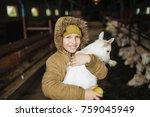 Little Cute Boy Hugging Goat O...